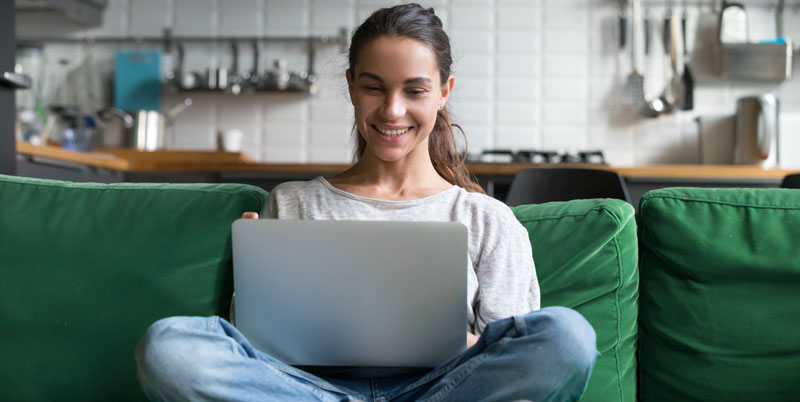 Young woman smiling with laptop